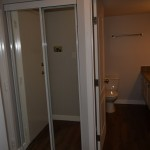 HALLWAY - Had to buy store price on sliding mirror doors...too bad!